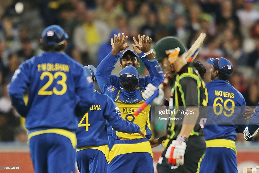 The Sri Lankans celebrate after dismissing David Warner of Australia (2nd R) during game two of the Twenty20 International series between Australia and Sri Lanka at the Melbourne Cricket Ground on January 28, 2013 in Melbourne, Australia.