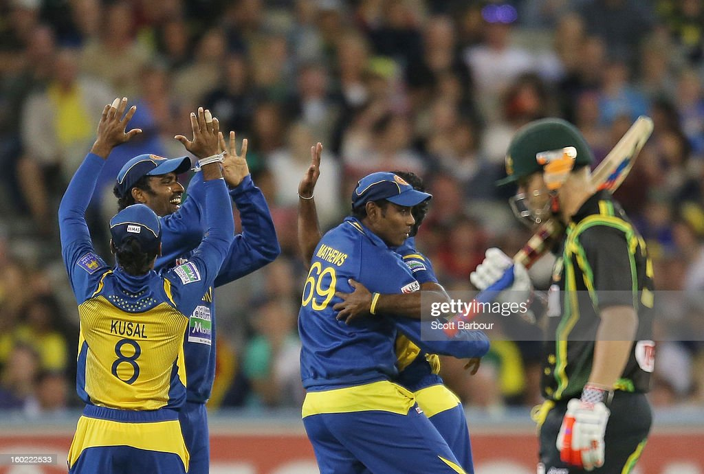 The Sri Lankans celebrate after dismissing David Warner of Australia (R) during game two of the Twenty20 International series between Australia and Sri Lanka at the Melbourne Cricket Ground on January 28, 2013 in Melbourne, Australia.