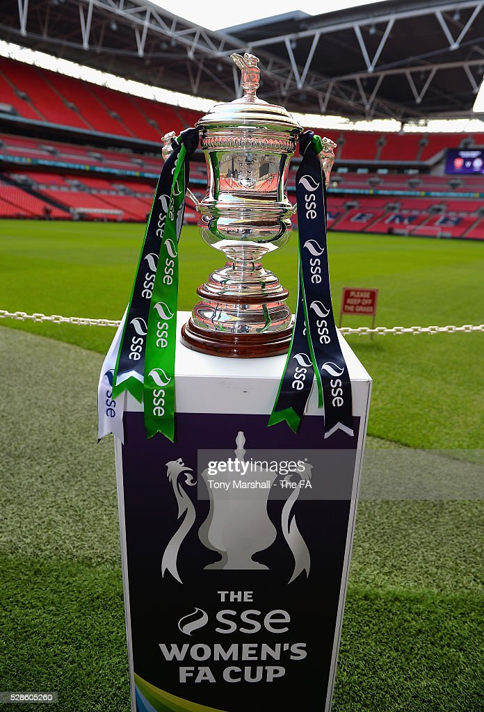 The SSE Women's FA Cup stands next to the Wembley Stadium pitch during the SSE Women's FA Cup Final - Wembley Media Day at Wembley Stadium on May 6, 2016 in London, England.