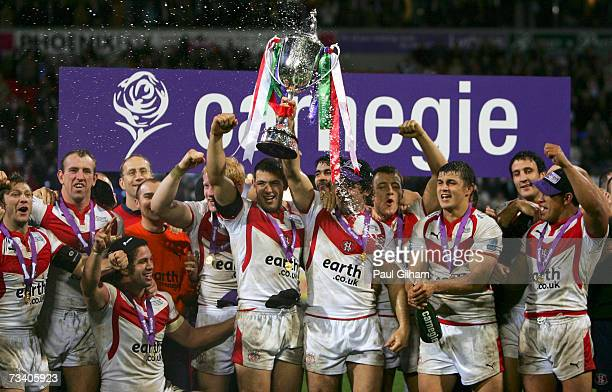 The St Helens players celebrate their victory with the trophy at the end of the Carnegie World Club Challenge match between St Helens and Brisbane...
