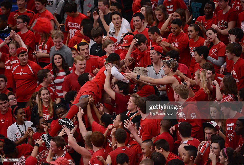 The St. John's fans send a student body surfing up through the student section during the WCAC Basketball Championship at Bender Arena on Tuesday, February 26, 2013. Bishop O'Connell defeated St. John's 58-53 for the title.