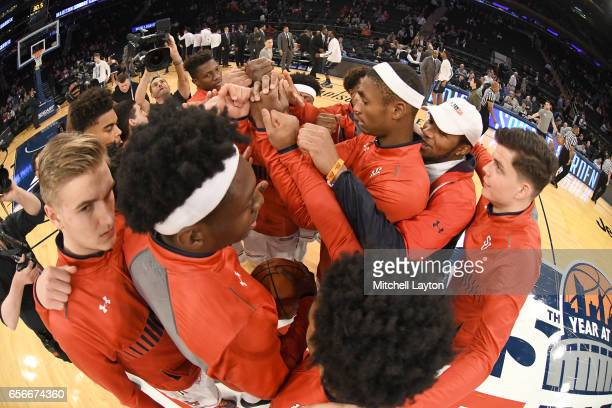 The St John's Red Storm huddle before the Big East Basketball Tournament First Round game against the Georgetown Hoyas at Madison Square Garden on...