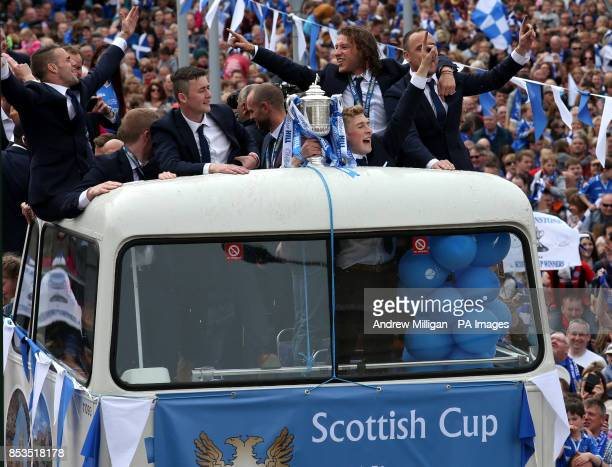 The St Johnstone team make their way through the crowds on an open top bus during the Scottish Cup winners parade in Perth PRESS ASSOCIATION Photo...