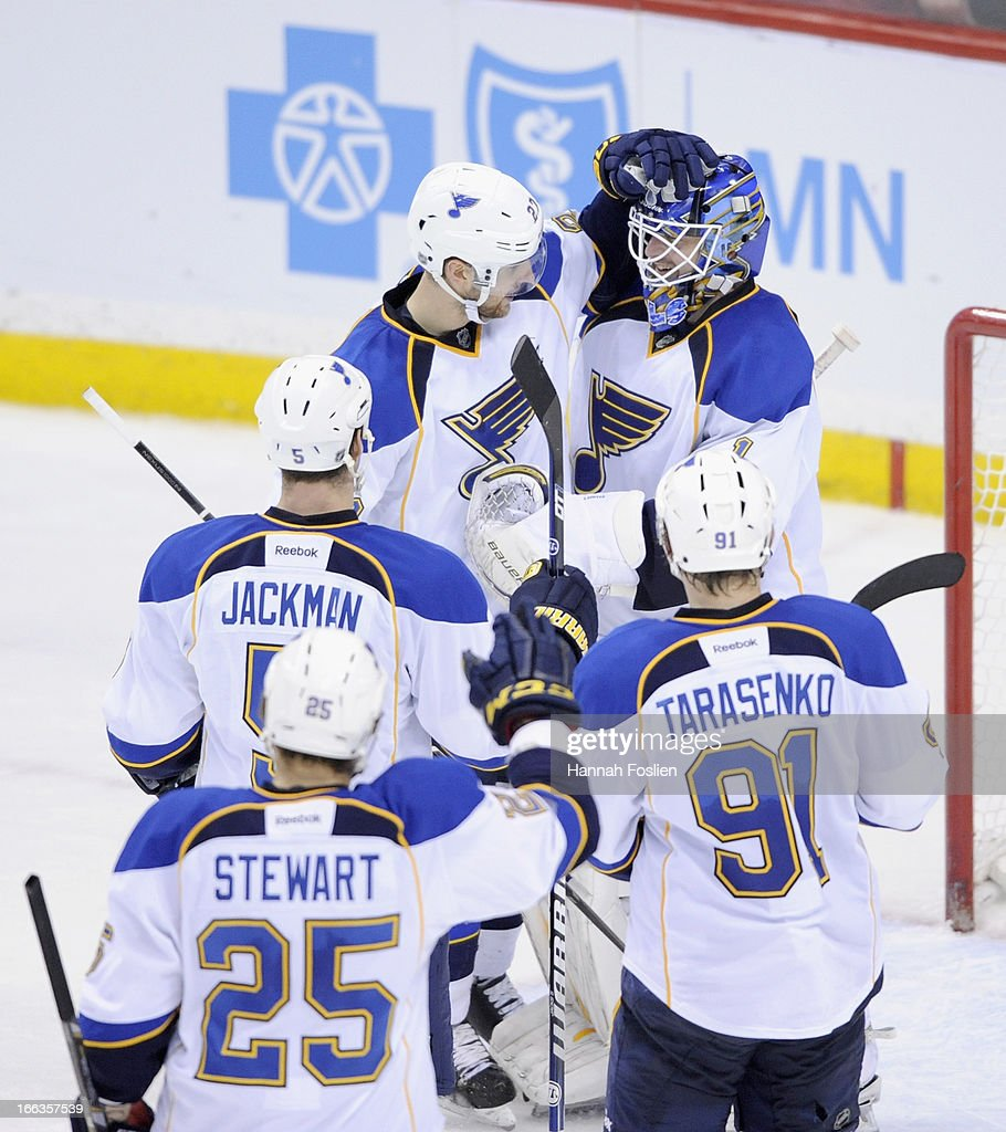 The St. Louis Blues congratulate <a gi-track='captionPersonalityLinkClicked' href=/galleries/search?phrase=Brian+Elliott&family=editorial&specificpeople=687032 ng-click='$event.stopPropagation()'>Brian Elliott</a> #1 after the game against the Minnesota Wild on April 11, 2013 at Xcel Energy Center in St Paul, Minnesota. The Blues defeated the Wild 2-0.