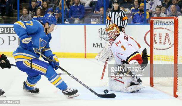 The St Louis Blues' Jaden Schwartz left scores past Calgary Flames goaltender Brian Elliott in the third period on Saturday March 25 at the Scottrade...