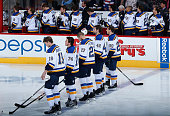 The St Louis Blues line up for the national anthem before the NHL game against the Arizona Coyotes at Gila River Arena on January 6 2015 in Glendale...