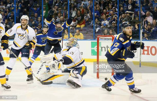The St Louis Blues' Vladimir Tarasenko middle celebrates after teammate Jaden Schwartz right scored the goahead goal against Nashville Predators...