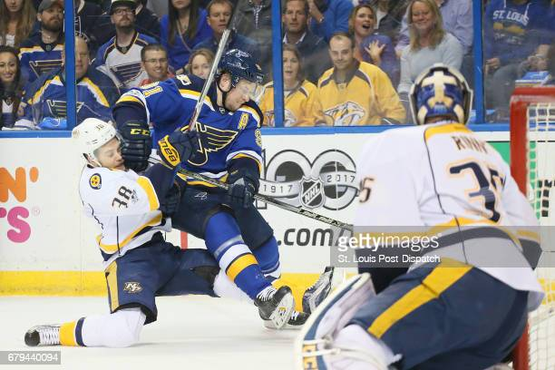 The St Louis Blues' Vladimir Tarasenko middle is defended by the Nashville Predators' Viktor Arvidsson in the first period during Game 5 of the...