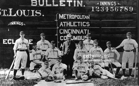 The St Louis Browns of the American Association pose for a portrait in their home town in 1883 Hall of Fame member Charlie Comiskey stands in street...
