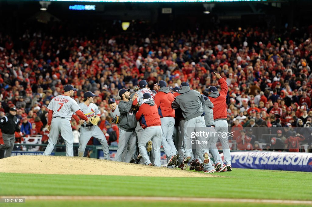 The St. Louis Cardinals celebrate after a victory against the Washington Nationals in Game Five of the National League Division Series at Nationals Park on October 12, 2012 in Washington, DC.
