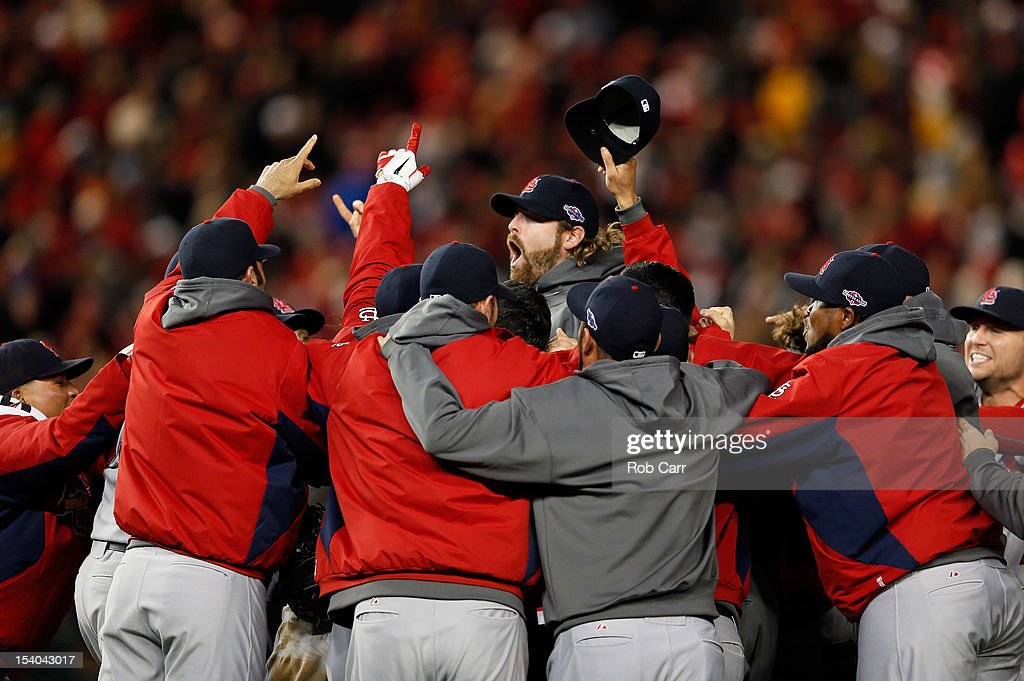 The St. Louis Cardinals celebrate after defeating the Washington Nationals 9-7 in Game Five of the National League Division Series at Nationals Park on October 12, 2012 in Washington, DC.