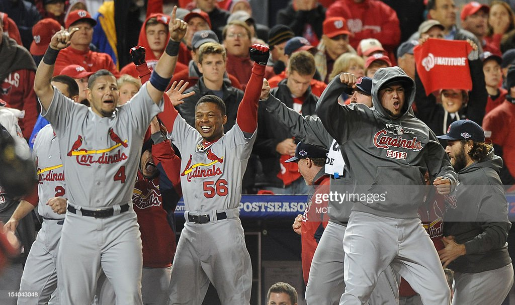 The St. Louis Cardinals celebrate after defeating the Washington Nationals, 9-7, in Game 5 of the National League Division Series at Nationals Park in Washington, D.C., Saturday, October 13, 2012.