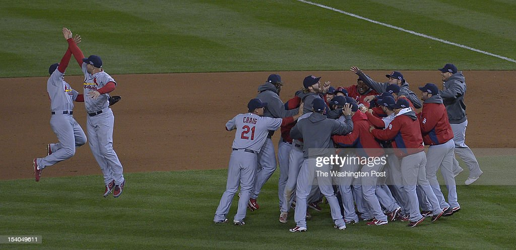 The St. Louis Cardinals celebrate after defeating the Washington Nationals 9-7 in the NLDS Game 5 at Nationals Park on October 12, 2012 in Washington, D.C.