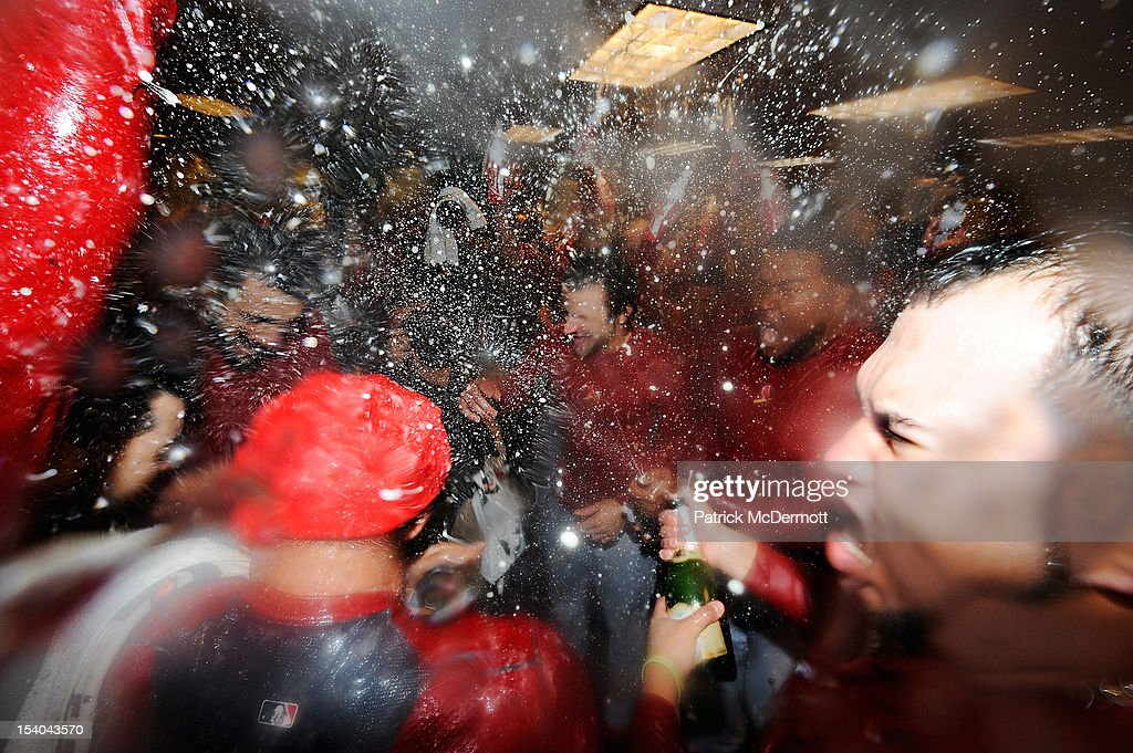 The St. Louis Cardinals celebrate in the locker room after defeating the Washington Nationals 9-7 in Game Five of the National League Division Series at Nationals Park on October 12, 2012 in Washington, DC.