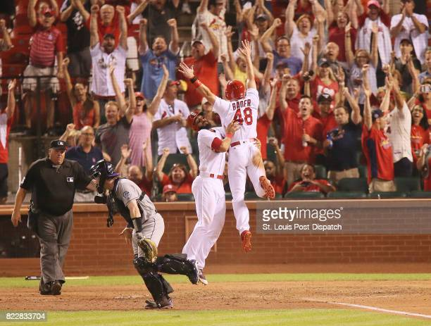 The St Louis Cardinals' Harrison Bader celebrates with teammate Matt Carpenter after he scored the gamewinning run on a sacrifice fly by Jedd Gyorko...