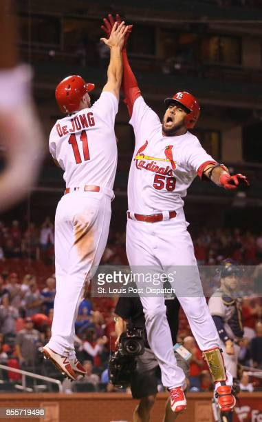 The St Louis Cardinals' Jose Martinez right celebrates with Paul DeJong after he drove in DeJong with a tworun home run in the ninth inning against...