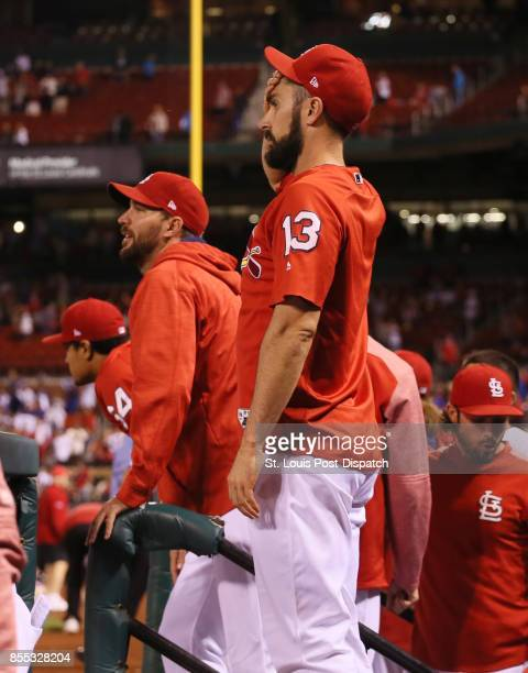 The St Louis Cardinals' Matt Carpenter middle and Adam Wainwright second from left react after Chicago Cubs center fielder Leonys Martin robbed a...