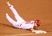 The St Louis Cardinals' Mike Leake dives safely back to first base against the Washington Nationals with a pickoff attempt in the fourth inning on...