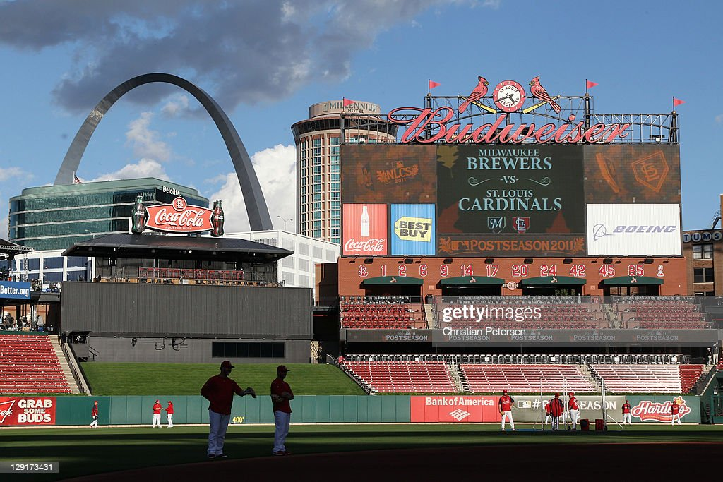 The St. Louis Cardinals warm up in the field during batting practice against the Milwaukee Brewers during Game 4 of the National League Championship Series at Busch Stadium on October 13, 2011 in St. Louis, Missouri.
