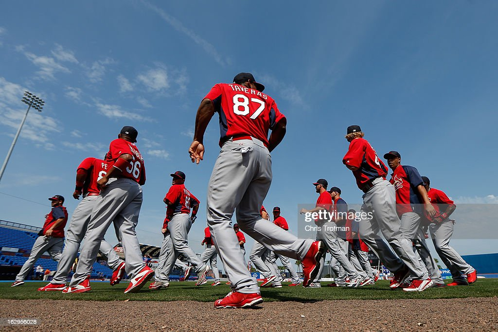 The St. Louis Cardinals warm up prior to the game against the New York Mets at Tradition Field on February 27, 2013 in Port St. Lucie, Florida.