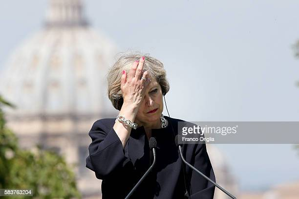 The St Peter's Basilica cupole is seen on the background as UK Prime Minister Theresa May attends a press conference at the end of a meeting at Villa...