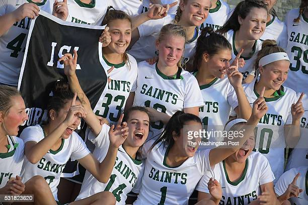 The St Stephens St Agnes Saints celebrate with the championship banner May 16 2016 in Bethesda MD The St Stephens St Agnes Saints beat the Georgetown...