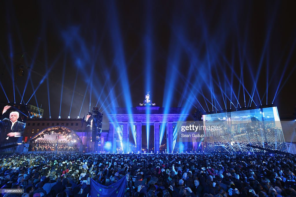 The Staatskapelle Berlin under the direction of Daniel Barenboim performs in front of the Brandenburg Gate during celebrations on the 25th anniversary of the fall of the Berlin Wall on November 9, 2014 in Berlin, Germany. The city of Berlin is commemorating the 25th anniversary of the fall of the Berlin Wall with an installation of 6,800 lamps coupled with illuminated balloons along a 15km route where the Wall once ran and divided the city into capitalist West and communist East. The fall of the Wall on November 9, 1989, was among the most powerful symbols of the revolutions that swept through the communist countries of Eastern Europe and heralded the end of the Cold War. Built by the communist authorities of East Germany in 1961, the Wall prevented East Germans from fleeing west and was equipped with guard towers and deadly traps.