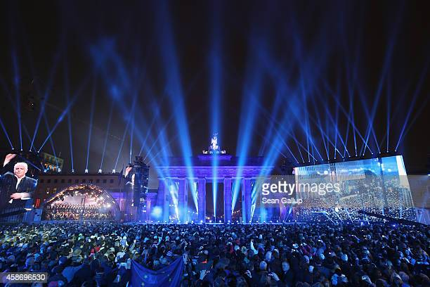 The Staatskapelle Berlin under the direction of Daniel Barenboim performs in front of the Brandenburg Gate during celebrations on the 25th...