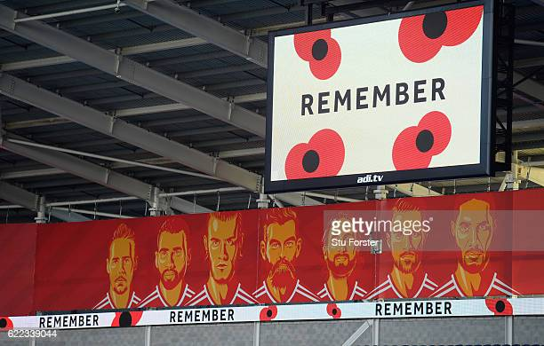 The stadium screen displays a remembrance sign during a two minute silence to mark November 11th before Wales training prior to the FIFA 2018 World...