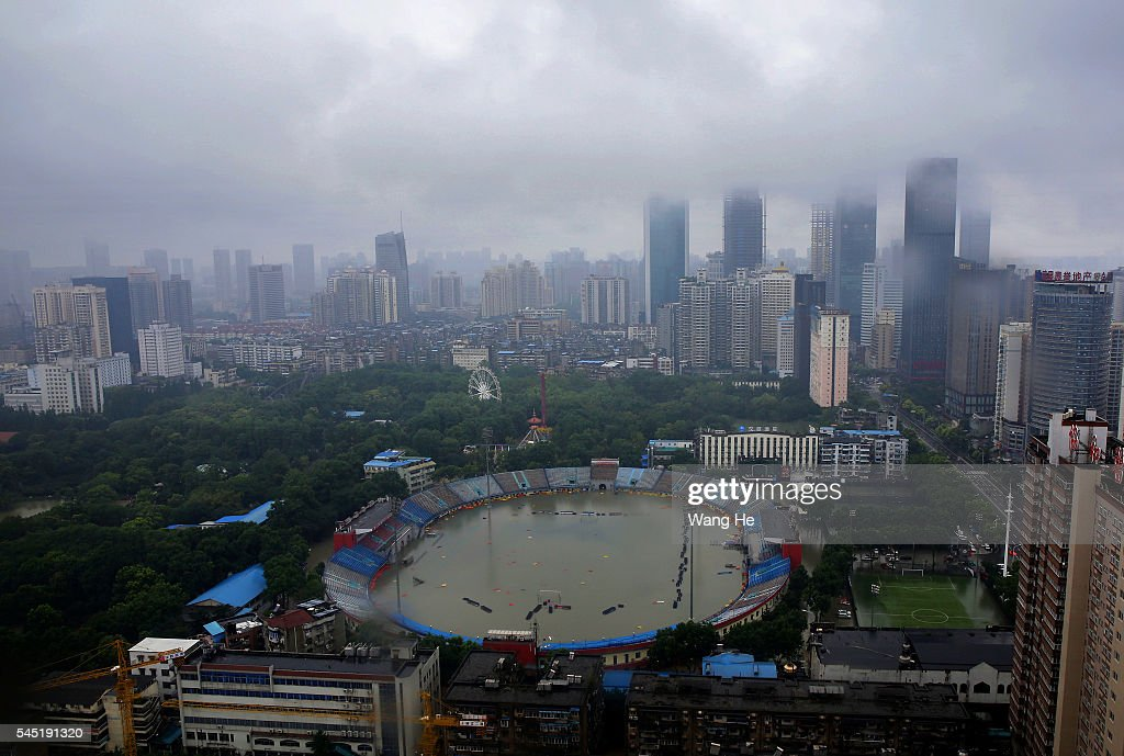 The stadium was flooded in Wuhan £¬Hubei province China6 July 2016 An overnight storm following days of rain has stopped traffic cut power and water...