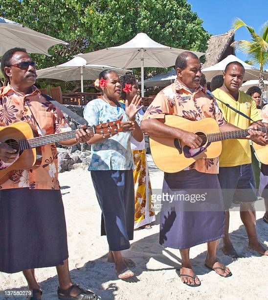 The staff sings a welcome song as visitors arrive at Castaway Resort Qalito Island Fijii