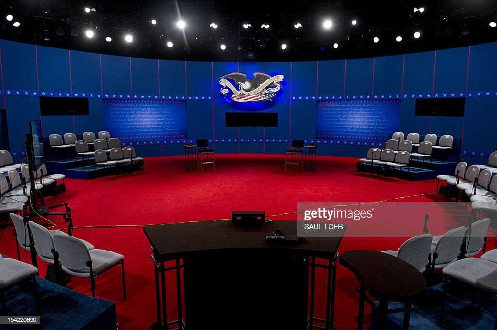 The stage is set prior to the second presidential debate to be held at the David Mack Center at Hofstra University in Hempstead, New York, October 16, 2012. US President Barack Obama and Republican Presidential candidate Mitt Romney will face off later Tuesday in a town-hall style debate with undecided voters asking questions of the two candidates. AFP PHOTO / Saul LOEB