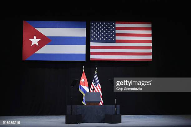 The stage is set with the flags of Cuba and America for US President Barack Obama's remarks at the Gran Teatro de la Habana Alicia Alonso in the Old...