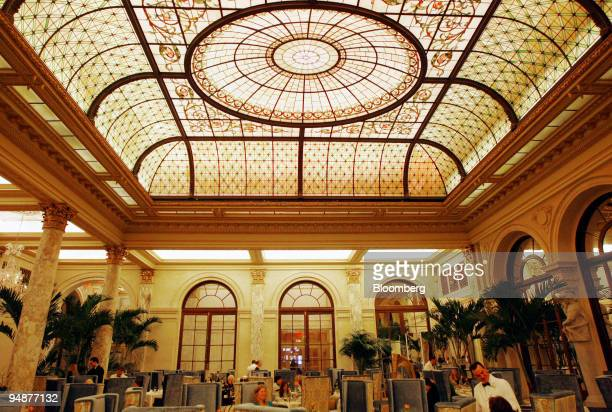 The stained glass ceiling is illuminated during tea service in the Palm Court at the Plaza Hotel in New York US on Monday March 17 2008 Recession...