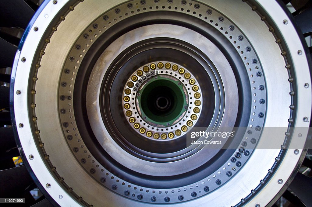The stainless steel spinning shaft of a jet airliner turbofan engine. : Stock Photo