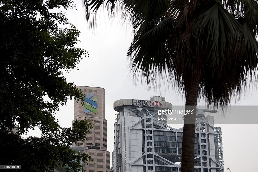 The Standard Chartered Bank building, left, stands next to the HSBC Holdings Plc headquarters in Hong Kong, China, on Friday, July 20, 2012. Traders at Deutsche Bank AG, HSBC Holdings Plc, Societe Generale SA and Credit Agricole SA are under investigation for interest-rate manipulation in a global probe that led to a record fine for Barclays Plc last month, a person with knowledge of the matter said. Photographer: Jerome Favre/Bloomberg via Getty Images