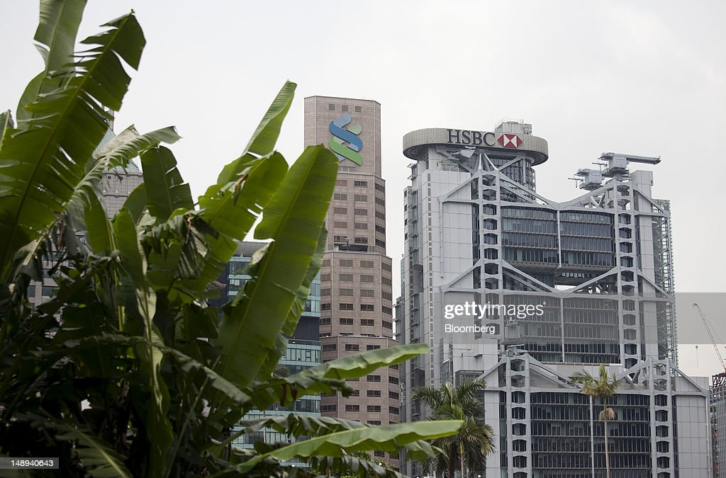 The Standard Chartered Bank building, second right, stands next to the HSBC Holdings Plc headquarters in Hong Kong, China, on Friday, July 20, 2012. Traders at Deutsche Bank AG, HSBC Holdings Plc, Societe Generale SA and Credit Agricole SA are under investigation for interest-rate manipulation in a global probe that led to a record fine for Barclays Plc last month, a person with knowledge of the matter said. Photographer: Jerome Favre/Bloomberg via Getty Images