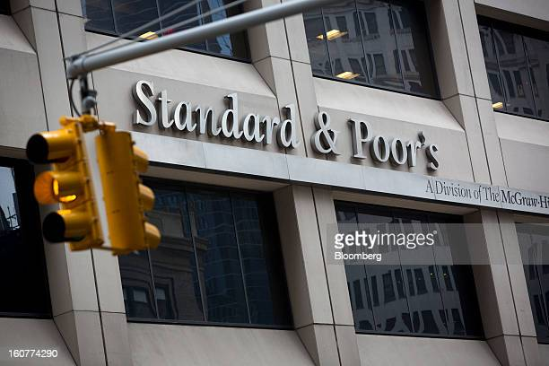 The Standard Poor's logo is displayed at the company's headquarters in New York US on Tuesday Feb 5 2013 The US is seeking as much as $5 billion in...
