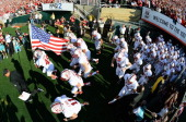 The Stanford Cardinal take the field against the Michigan State Spartans prior to the 100th Rose Bowl Game presented by Vizio at the Rose Bowl on...