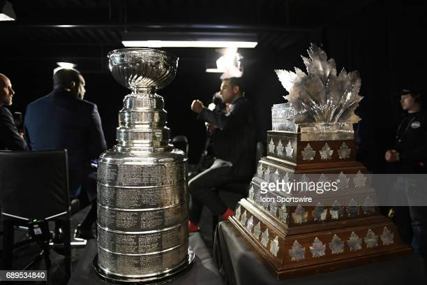 The Stanley Cup and the Conn Smythe Trophy are displayed during the NHL Stanley Cup Final Media Day at PPG Paints Arena in Pittsburgh on May 28 2017