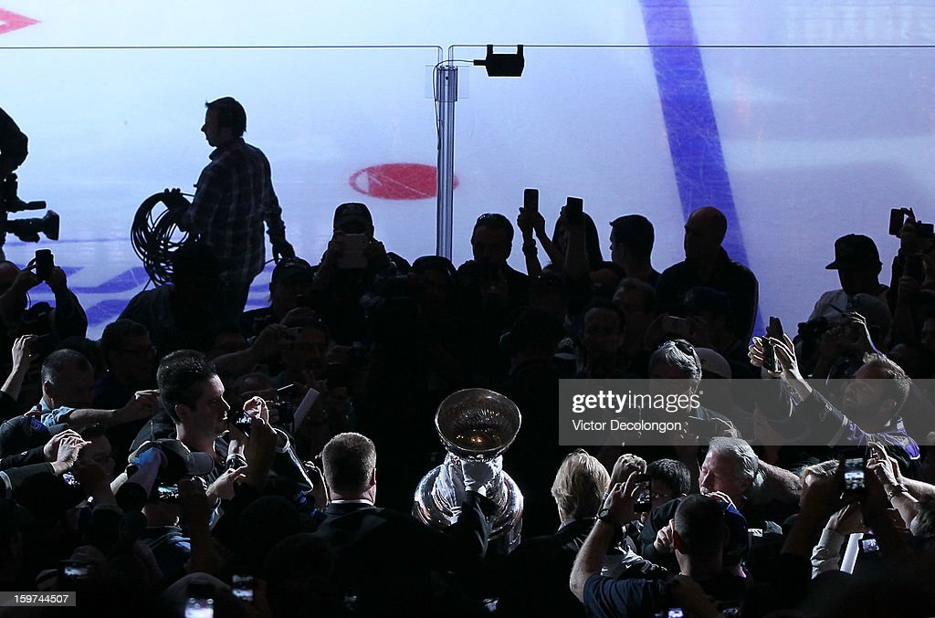 The Stanley Cup is carried through a crowd of fans in the arena on its way to the ice prior to the NHL game between the Chicago Blackhawks and the Los Angeles Kings at Staples Center on January 19, 2013 in Los Angeles, California. The Blackhawks defeated the Kings 5-2.