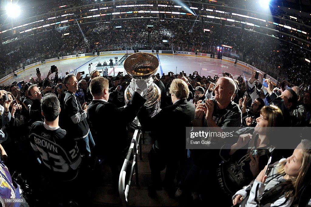 The Stanley Cup is carried through the crowd prior to the game between the Los Angeles Kings and the Chicago Blackhawks at Staples Center on January 19, 2013 in Los Angeles, California.