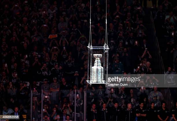 The Stanley Cup is lowered to the ice during ceremonies for the Los Angeles Kings before playing the San Jose Sharks in their NHL season opener at...