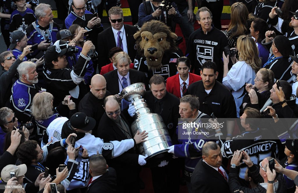 The Stanley Cup is walked into Staples Center through fans prior to the game between the Los Angeles Kings and the Chicago Blackhawks at Staples Center on January 19, 2013 in Los Angeles, California.