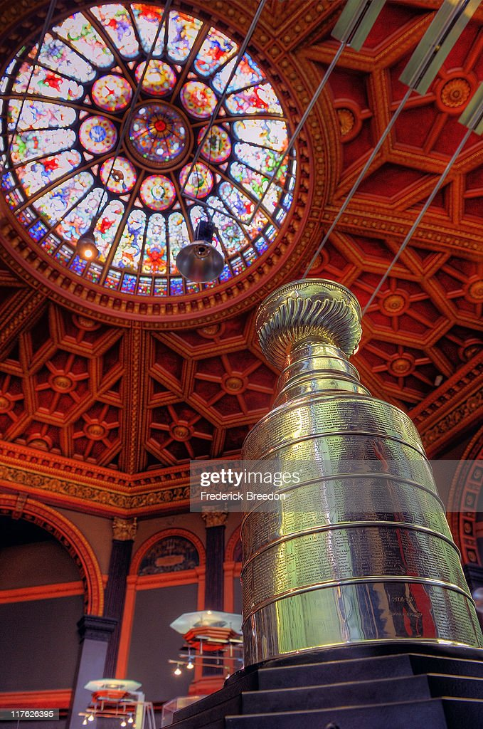 The Stanley Cup rests below a stained glass dome in the Great Hall of the Hockey Hall of Fame June 21 2011 in Toronto Ontario Canada