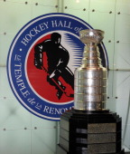 The Stanley Cup rests in front of the Hockey Hall of Fame logo in the Great Hall of the Hockey Hall of Fame June 21 2011 in Toronto Ontario Canada