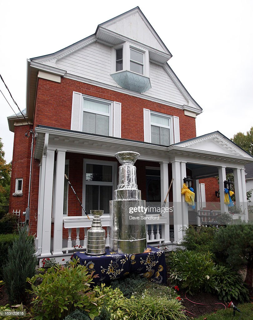 The Stanley Cup sits beside a giant replica Stanley Cup on the lawn of one of the local residents of Stirling during Kraft Hockeyville Day 1 on September 30, 2012 in Stirling, Ontario, Canada.