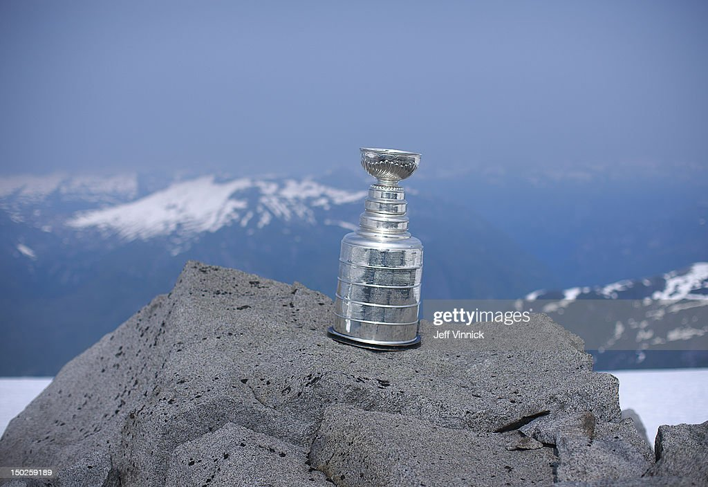 The Stanley Cup sits on a rocky bluff at the top of Mount Benedict August 12, 2012 near Port McNeill, British Columbia, Canada. Willie Mitchell #33 of the Los Angeles Kings took the Stanley Cup to his hometown of Port McNeill, B.C. for his one-day celebration with the prized trophy.