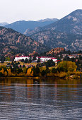 The Stanley Hotel surrounded by Autumn Trees.