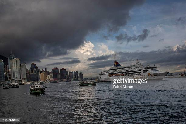 The Star Ferry can be seen crossing Victoria Harbour on a stormy morning on June 6 2014 in Hong KongThe ferry which connects Hong Kong island to the...